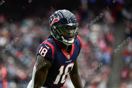 Houston Texans wide receiver Chris Conley (18) gets up after being tackled in the red zone against the New England Patriots during the first half of an NFL football game, in Houston