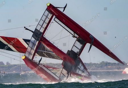 Great Britain SailGP Team helmed by Ben Ainslie capsize during the final race on Race Day 2 at Spain SailGP. Handout image supplied by SailGP