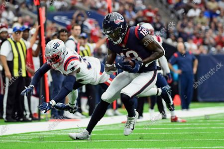 Houston Texans wide receiver Chris Conley (18) breaks away from New England Patriots safety Devin McCourty after catching a pass during the first half of an NFL football game, in Houston