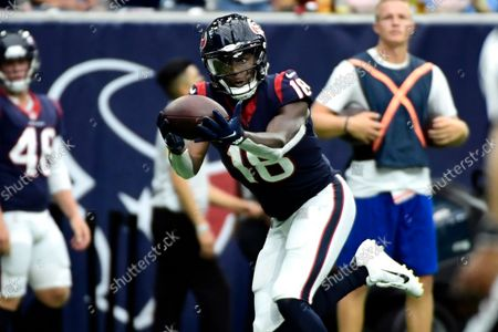 Houston Texans wide receiver Chris Conley (18) makes a touchdown catch against the New England Patriots during the second half of an NFL football game, in Houston
