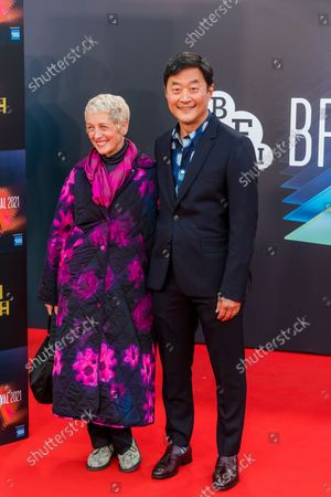 Stephen Park (R) and his partner Kelly Coffield Park (L) attend the UK premiere of 'The French Dispatch' during the BFI London Film Festival at the Royal Festival Hall in London, Britain, 10 October 2021. The British Film Institute festival runs from 06 to 17 October 2021.