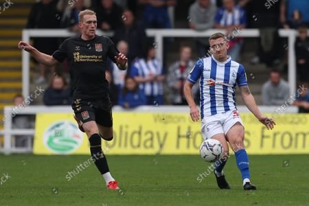Hartlepool United's David Ferguson and Mitch Pinnock of Northampton Town during the Sky Bet League 2 match between Hartlepool United and Northampton Town at Victoria Park, Hartlepool on Saturday 9th October 2021.