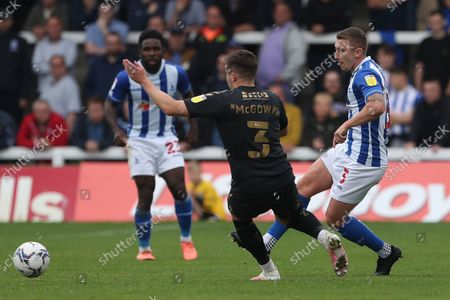 David Ferguson of Hartlepool United in action with Northampton Town's Aaron McGowan during the Sky Bet League 2 match between Hartlepool United and Northampton Town at Victoria Park, Hartlepool on Saturday 9th October 2021.