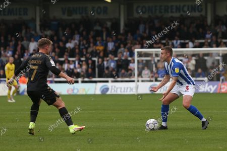 David Ferguson of Hartlepool United and Sam Hoskins of Northampton Town  during the Sky Bet League 2 match between Hartlepool United and Northampton Town at Victoria Park, Hartlepool on Saturday 9th October 2021.