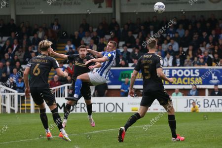 Hartlepool United's David Ferguson scores their first goal to level the score at 1-1  during the Sky Bet League 2 match between Hartlepool United and Northampton Town at Victoria Park, Hartlepool on Saturday 9th October 2021.