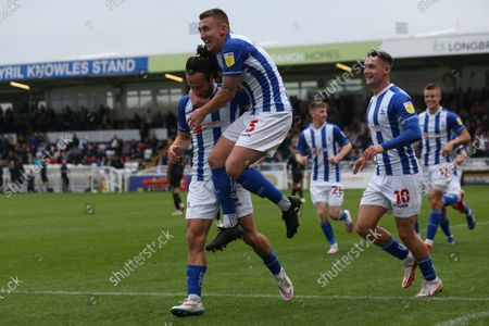 David Ferguson of Hartlepool United celebrates with Jamie Sterry after scoring their first goal to make it 1-1 during the Sky Bet League 2 match between Hartlepool United and Northampton Town at Victoria Park, Hartlepool on Saturday 9th October 2021.