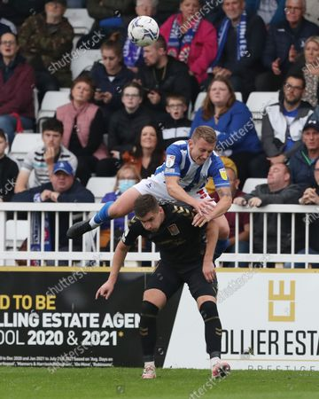 Stock Image of David Ferguson of Hartlepool United battles with Northampton Town's Aaron McGowan during the Sky Bet League 2 match between Hartlepool United and Northampton Town at Victoria Park, Hartlepool on Saturday 9th October 2021.