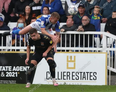 Stock Photo of David Ferguson of Hartlepool United battles with Northampton Town's Aaron McGowan during the Sky Bet League 2 match between Hartlepool United and Northampton Town at Victoria Park, Hartlepool on Saturday 9th October 2021.