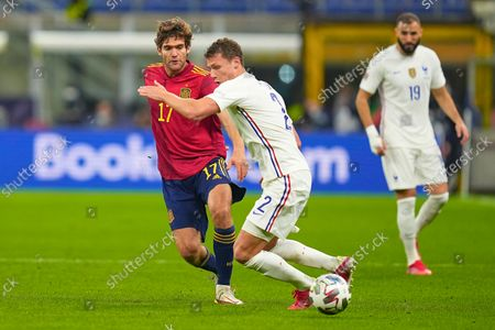 Marcos Alonso of Spain and Benjamin Pavard of France