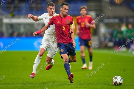 Sergio Busquets of Spain and Benjamin Pavard of France
