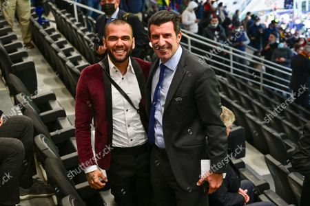 Stock Photo of Brazil Footballer Daniel Alves, left, and former Portugal International Luis Figo pose for a photo during the UEFA Nations League final soccer match between Spain and France at the San Siro stadium, in Milan, Italy