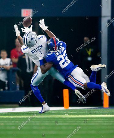 Dallas Cowboys wide receiver Cedrick Wilson (1) catches a pass as New York Giants cornerback Adoree' Jackson (22) defends during an NFL football game, in Arlington, Texas. Dallas won 44-20