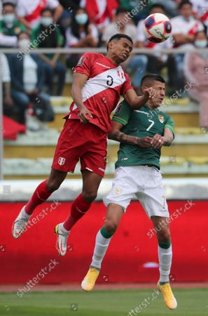 Peru's Marcos Lopez, left, and Bolivia's Juan Carlos Arce go for a header during a qualifying soccer match for the FIFA World Cup Qatar 2022 at Hernando Siles stadium in La Paz, Bolivia
