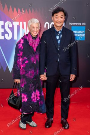 """Kelly Park and Stephen Park attend the UK Premiere and Headline Gala of Searchlight Picture's """"The French Dispatch"""" at The Royal Festival Hall on October 10, 2021 in London, England"""
