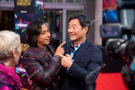 """Stock Picture of Mario Revolori and Stephen Park attend the UK Premiere and Headline Gala of Searchlight Picture's """"The French Dispatch"""" at The Royal Festival Hall on October 10, 2021 in London, England"""
