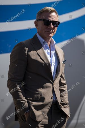 Stock Photo of Actor and honorary starter Daniel Craig poses in Victory Lane prior to a NASCAR Cup Series auto racing race at Charlotte Motor Speedway, in Concord, N.C