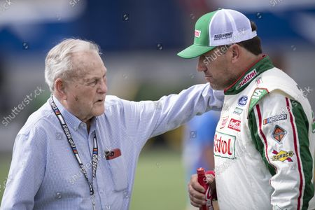 Stock Photo of Driver Ryan Newman, right, and Humpy Wheeler have a conversation prior to a NASCAR Cup Series auto racing race at Charlotte Motor Speedway, in Concord, N.C