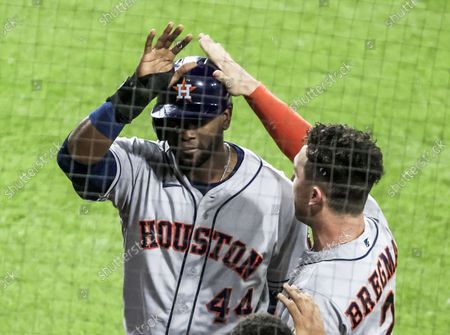 Stock Image of Houston Astros designated hitter Yordan Alvarez (L) gets a pat on the head from Houston Astros third baseman Alex Bregman (R) after scoring on a double hit by Houston Astros right fielder Kyle Tucker in the second inning of game three of the Major League Baseball (MLB) American League Division Series between the Houston Astros and the Chicago White Sox at Guaranteed Rate Field in Chicago, Illinois, USA, 10 October 2021.