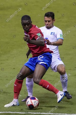 Stock Image of Costa Rica's Joel Campbell (12) is challenged by El Salvador's Joshua Perez during a qualifying soccer match for the FIFA World Cup Qatar 2022 at the National Stadium in San Jose, Costa Rica