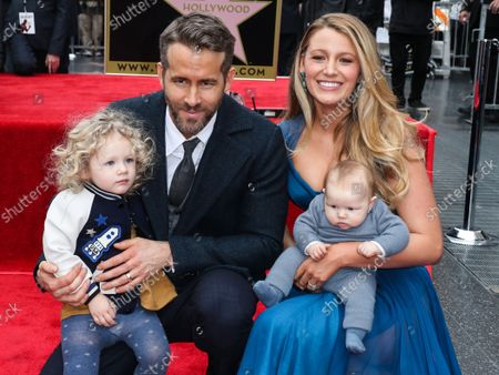 FILE - Ryan Reynolds And Blake Lively Donate $400,000 to New York Hospitals Amid Coronavirus COVID-19 Pandemic. They are reportedly donating $100,000 each to Elmhurst, NYU Hospital, Mount Sinai, and Northern Westchester. HOLLYWOOD, LOS ANGELES, CALIFORNIA, USA - DECEMBER 15: Actor Ryan Reynolds and wife/actress Blake Lively pose with daughters James Reynolds and Inez Reynolds at a ceremony honoring Ryan Reynolds with a star on the Hollywood Walk of Fame - Dedication of the 2,596th star on the Walk of Fame in the category of Motion Pictures on December 15, 2015 in Hollywood, Los Angeles, California, United States.