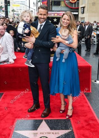 Stock Picture of FILE - Ryan Reynolds And Blake Lively Donate $400,000 to New York Hospitals Amid Coronavirus COVID-19 Pandemic. They are reportedly donating $100,000 each to Elmhurst, NYU Hospital, Mount Sinai, and Northern Westchester. HOLLYWOOD, LOS ANGELES, CALIFORNIA, USA - DECEMBER 15: Actor Ryan Reynolds and wife/actress Blake Lively pose with daughters James Reynolds and Inez Reynolds at a ceremony honoring Ryan Reynolds with a star on the Hollywood Walk of Fame - Dedication of the 2,596th star on the Walk of Fame in the category of Motion Pictures on December 15, 2015 in Hollywood, Los Angeles, California, United States.