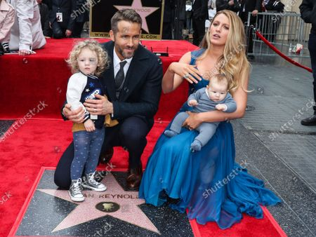 Stock Photo of FILE - Ryan Reynolds And Blake Lively Donate $400,000 to New York Hospitals Amid Coronavirus COVID-19 Pandemic. They are reportedly donating $100,000 each to Elmhurst, NYU Hospital, Mount Sinai, and Northern Westchester. HOLLYWOOD, LOS ANGELES, CALIFORNIA, USA - DECEMBER 15: Actor Ryan Reynolds and wife/actress Blake Lively pose with daughters James Reynolds and Inez Reynolds at a ceremony honoring Ryan Reynolds with a star on the Hollywood Walk of Fame - Dedication of the 2,596th star on the Walk of Fame in the category of Motion Pictures on December 15, 2015 in Hollywood, Los Angeles, California, United States.