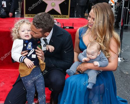 Stock Image of FILE - Ryan Reynolds And Blake Lively Donate $400,000 to New York Hospitals Amid Coronavirus COVID-19 Pandemic. They are reportedly donating $100,000 each to Elmhurst, NYU Hospital, Mount Sinai, and Northern Westchester. HOLLYWOOD, LOS ANGELES, CALIFORNIA, USA - DECEMBER 15: Actor Ryan Reynolds and wife/actress Blake Lively pose with daughters James Reynolds and Inez Reynolds at a ceremony honoring Ryan Reynolds with a star on the Hollywood Walk of Fame - Dedication of the 2,596th star on the Walk of Fame in the category of Motion Pictures on December 15, 2015 in Hollywood, Los Angeles, California, United States.