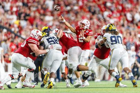 Lincoln, NE. U.S. - As the pocket collapses, Nebraska Cornhuskers quarterback Adrian Martinez #2 lets go of a pass in action during a NCAA Division 1 football game between Michigan Wolverines and the Nebraska Cornhuskers at Memorial Stadium in Lincoln, NE. .Michigan won 32-29.Attendance: 87,370