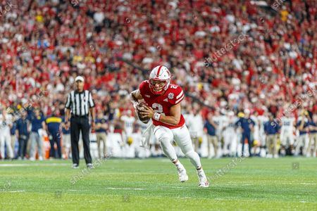 Lincoln, NE. U.S. - Nebraska Cornhuskers quarterback Adrian Martinez #2 breaks around the left side before scoring a rushing touchdown in action during a NCAA Division 1 football game between Michigan Wolverines and the Nebraska Cornhuskers at Memorial Stadium in Lincoln, NE. .Michigan won 32-29.Attendance: 87,370