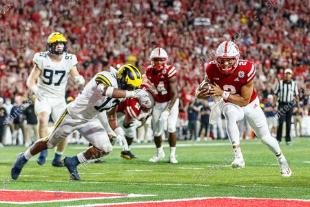 Lincoln, NE. U.S. - Nebraska Cornhuskers quarterback Adrian Martinez #2 scores a rushing touchdown in action during a NCAA Division 1 football game between Michigan Wolverines and the Nebraska Cornhuskers at Memorial Stadium in Lincoln, NE. .Michigan won 32-29.Attendance: 87,370