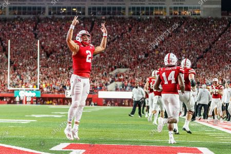 Lincoln, NE. U.S. - Nebraska Cornhuskers quarterback Adrian Martinez #2 reacts to the crowd after scoring a rushing touchdown in action during a NCAA Division 1 football game between Michigan Wolverines and the Nebraska Cornhuskers at Memorial Stadium in Lincoln, NE. .Michigan won 32-29.Attendance: 87,370