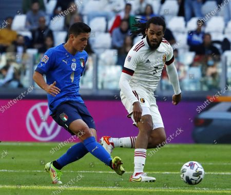 (211011) - TURIN, Oct. 11, 2021 (Xinhua) - Italy's Giacomo Raspadori (L) lives with Belgium's Jason Denayer during the UEFA Nations League third place play-off match between Italy and Belgium in Turin, Italy, Oct. 10, 2021.