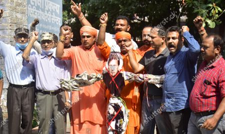 Members of Bajrang Dal and Vishva Hindu Parishad (VHP) shout slogans as they burn an effigy of Pakistani Prime Minister Imran Khan during a protest against the recent terror attack in Srinagar where two school teachers were shot dead, on October 10, 2021 in Amritsar, India.