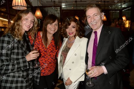 Dame Joan Collins and Andrew Pierce (centre right and right) at the J Sheekey restaurant