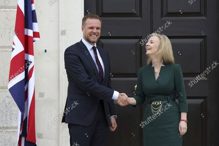 British Foreign Secretary Liz Truss, right, greets Lithuanian Foreign Minister Gabrielius Landsbergis on the occasion of their meeting, at Chevening House in Kent, England