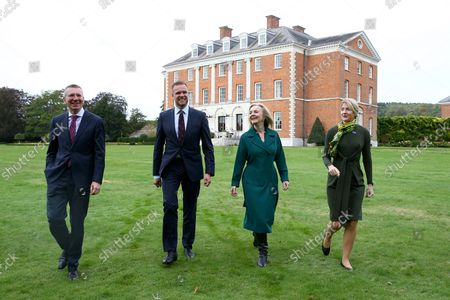 British Foreign Secretary Liz Truss, second from right, walks with Latvian Foreign Minister Edgars Rinkvis, left, Lithuanian Foreign Minister Gabrielius Landsbergis, second from left, and Estonian Foreign Minister Eva-Maria Liimets, right, on the occasion of their meeting, at Chevening House in Kent, England