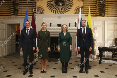 British Foreign Secretary Liz Truss, second from right, poses for a group photo with Latvian Foreign Minister Edgars Rinkvis, left, Estonian Foreign Minister Eva-Maria Liimets, second from left, and Lithuanian Foreign Minister Gabrielius Landsbergis, right, on the occasion of their meeting, at Chevening House in Sevenoaks, England