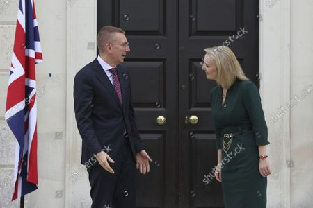 British Foreign Secretary Liz Truss, right, welcomes Latvian Foreign Minister Edgars Rinkvis on the occasion of their meeting, at Chevening House in Sevenoaks, England