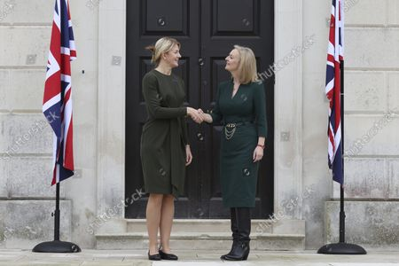 British Foreign Secretary Liz Truss, right, welcomes Estonian Foreign Minister Eva-Maria Liimets on the occasion of their meeting, at Chevening House in Sevenoaks, England