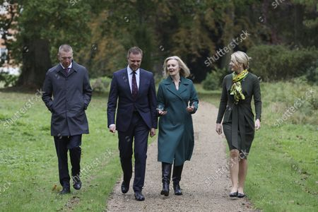 British Foreign Secretary Liz Truss, second from right, walks with Latvian Foreign Minister Edgars Rinkvis, left, Lithuanian Foreign Minister Gabrielius Landsbergis, second from left, and Estonian Foreign Minister Eva-Maria Liimets, right, on the occasion of their meeting, at Chevening House in Sevenoaks, England
