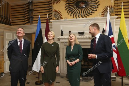 British Foreign Secretary Liz Truss, second from right, shares a laugh with Latvian Foreign Minister Edgars Rinkvis, left, Estonian Foreign Minister Eva-Maria Liimets, second from left, and Lithuanian Foreign Minister Gabrielius Landsbergis, right, on the occasion of their meeting, at Chevening House in Sevenoaks, England