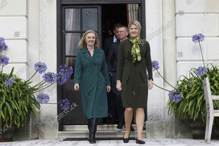 British Foreign Secretary Liz Truss, right, walks with Estonian Foreign Minister Eva-Maria Liimets, right, as Latvian Foreign Minister Edgars Rinkvis follows, on the occasion of their meeting, at Chevening House in Sevenoaks, England