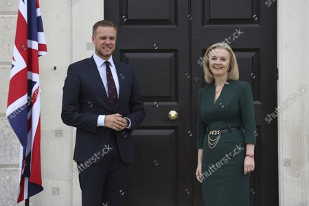 Stock Image of British Foreign Secretary Liz Truss, right, greets Lithuanian Foreign Minister Gabrielius Landsbergis on the occasion of their meeting, at Chevening House in Sevenoaks, England