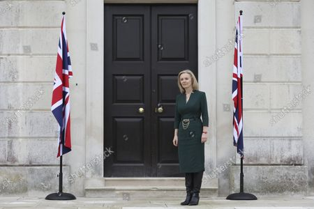 British Foreign Secretary Liz Truss waits to welcome three Baltic Foreign Ministers to Chevening House in Sevenoaks, England
