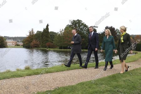 Stock Picture of British Foreign Secretary Liz Truss, second right, walks with Edgars Rinkvis, Foreign Minister of Latvia, left, Lithuanian Foreign Minister Gabrielius Landsbergis and Eva-Maria Liimets, Foreign Minister of Estonia, right, at Chevening House in Sevenoaks, England