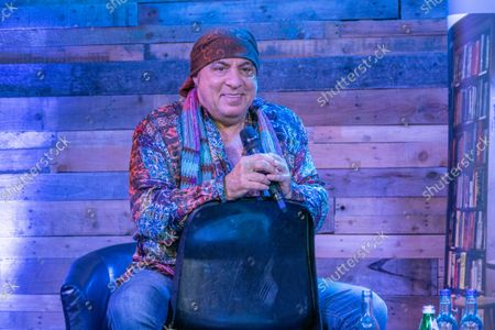 Stock Image of Steven Van Zandt giving a talk about his life at the Lighthouse Auditorium in Ely,Cambridgeshire as part of his book tour promoting his new autobiography called Unrequited Infatuations.