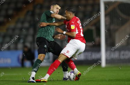 James Wilson of Plymouth Argyle battles for the ball with Jayden Mitchell Lawson of Swindon Town during the Papa JohnÕs Trophy Group stage match between Plymouth Argyle and Swindon Town on Tuesday 12th October 2021, Home Park, Plymouth, Devon - Photo: Dave Rowntree/PPAUK