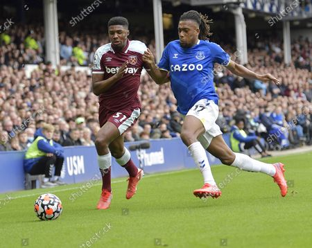 Ben Johnson of West Ham United in action with Alex Iwobi of Everton