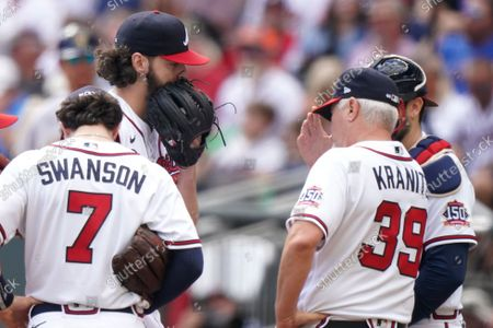 Atlanta Braves pitching coach Rick Kranitz (39) speaks with Atlanta Braves starting pitcher Ian Anderson (36) during the fifth inning of Game 3 of a baseball National League Division Series against the Milwaukee Brewers, in Atlanta
