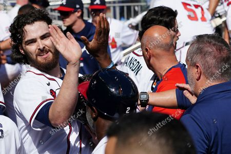 Atlanta Braves starting pitcher Ian Anderson (36) celebrates in the dugout after finishing the fifth inning of Game 3 of a baseball National League Division Series against the Milwaukee Brewers, in Atlanta